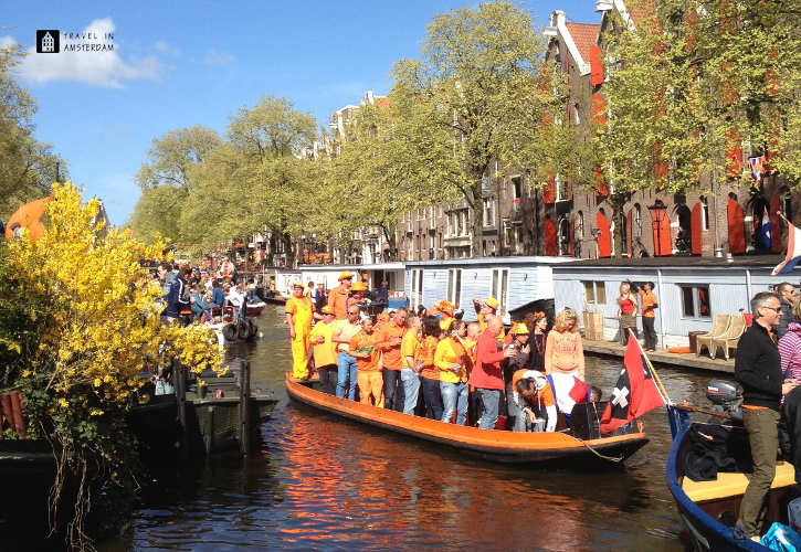 Boat in the canal on King's Day in Amsterdam